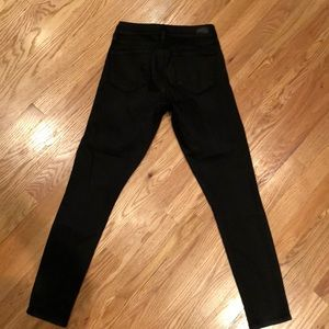 Black skinny jeans with glossy finish